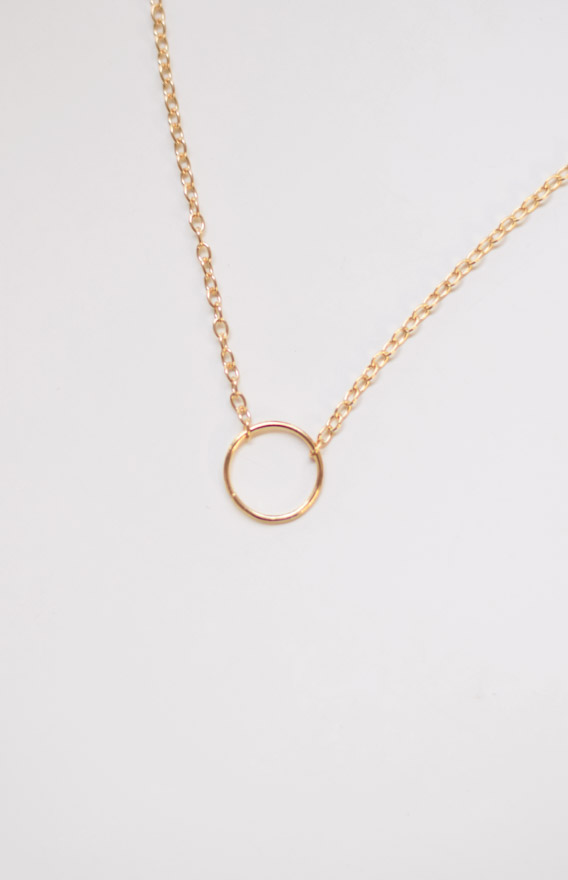 Base- Metal Alloy Adjustable length Sia Necklace features a ring pendant with dainty gold toned link chain to complement any outfit and add the extra oomph